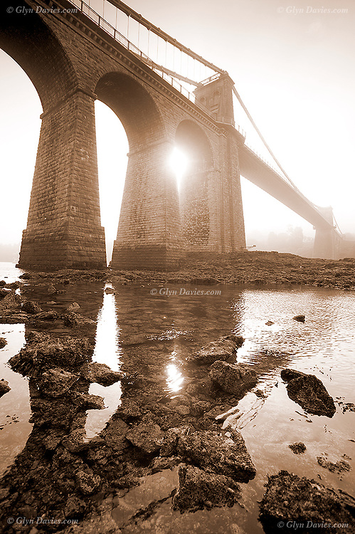 A year and a half on from my March Mist Series 2003, the Menai Suspension Bridge was once again shrouded in heavy mist. I was down at the water's edge at breakfast time and it was warm but quite eerie. The bridge occassionally disappeared into complete whiteness, but towards the end of the session a ghostly sun gently burnt through the mist, right in between the arch, and gave this wonderful mix of elemental conditions. Ten minutes later and the mist had evaporated to leave a gorgeous day.