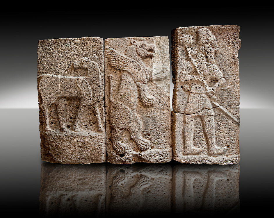 Late Hittite (Aramaean)  Basalt relief sculptures  from 9th Cent B.C, excavated from the west side of the citadel gate of Sam'al (Hittite: Yadiya) located at Zincirli Höyük in the Anti-Taurus Mountains of modern Turkey's Gaziantep Province. Left Deer Buck, Inv no 7712, Middle Winged Lion inv no. 7706, Left Male with Axe Inv No. 7727. Istanbul Archaeological Museum.Late Hittite (Aramaean)  Basalt relief sculpture of an Aslan Lion from 9th Cent B.C, excavated from the west side of the citadel gate of Sam'al (Hittite: Yadiya) located at Zincirli Höyük in the Anti-Taurus Mountains of modern Turkey's Gaziantep Province. Istanbul Archaeological Museum Inv. No 7727. .<br />  <br /> If you prefer to buy from our ALAMY STOCK LIBRARY page at https://www.alamy.com/portfolio/paul-williams-funkystock/hittite-art-antiquities.html  - Type -   Samal   - into the LOWER SEARCH WITHIN GALLERY box. Refine search by adding background colour, place, museum etc<br /> <br /> Visit our HITTITE PHOTO COLLECTIONS for more photos to download or buy as wall art prints https://funkystock.photoshelter.com/gallery-collection/The-Hittites-Art-Artefacts-Antiquities-Historic-Sites-Pictures-Images-of/C0000NUBSMhSc3Oo