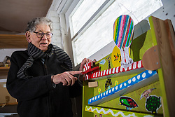 Retired product designer turned toy maker, whose many innovations became iconic household names Tom Karen is photographed with toys he created from recycled materials at his home in Cambridge, UK. <br /> PICTURED: Tom demonstrates his marble run created from recycled plastic.<br /> Cambridge, March 01 2018.