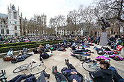Demonstrators hold up placards as they gather and lay down outside Parliament Square in central London on Sunday, March 14, 2021, during a protest over the abduction and murder of Sarah Everard and the subsequent handling by the police of a vigil honouring the victim. London's Metropolitan Police force was under heavy pressure Sunday to explain its actions during a vigil for Sarah Everard whom one of the force's own officers is accused of murdering. (VXP Photo/ Vudi Xhymshiti)