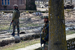 March 22, 2019 - Baramulla, Jammu and Kashmir, India - Indian army men are seen standing on guard near the gunfight site in Hajin Village of North Kashmir Baramulla some 40 kms from summer capital Srinagar..Indian forces killed five militants and Atif an 11 year old hostage during the separate gunfights in Kashmir, India. (Credit Image: © Idrees Abbas/SOPA Images via ZUMA Wire)