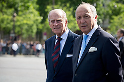 Buckingham Palace has announced Prince Philip, The Duke of Edinburgh, has passed away age 99 - FILE - Britain's Prince Philip, Duke of Edinburgh (L) and French Minister of Foreign Affairs, Laurent Fabius attend a ceremony. French President Francois Hollande and Britain's Queen Elizabeth II attend a wreath laying ceremony on the Tomb of the Unknown Soldier at the Arc de Triomphein PAris, France on June 5, 2014. Photo by Romuald Meigneux/Pool/ABACAPRESS.COM