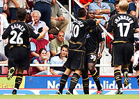Photo: Daniel Hambury<br /> Coca-Cola Championship.<br /> West Ham United V Wigan Athletic 15/08/2004<br /> <br /> Wigan Athletic's Jason Roberts (facing) celebrates his goal with team mates