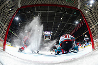 KELOWNA, BC - JANUARY 31: Cole Schwebius #31 of the Kelowna Rockets misses a save as Cordel Larson #16 of the Spokane Chiefs stops in front of the net to shoot during second period at Prospera Place on January 31, 2020 in Kelowna, Canada. (Photo by Marissa Baecker/Shoot the Breeze)