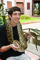 Tourist with snake, Samphran Elephant Ground & Zoo Nakhon Pathom province Thailand