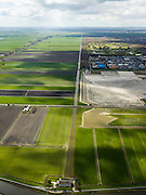 Nederland, Noord-Holland, Gemeente Purmerend, 16-04-2012; zicht op polder De Purmer langs de as van de Middentocht, poldergemaal in de voorgrond. Rechts opgespoten zand voor uitbreiding van het bedrijventerrein  De Baanstee..View on polder the Purmer and the city of Purmerend. Regular land division..luchtfoto (toeslag), aerial photo (additional fee required);.copyright foto/photo Siebe Swart.luchtfoto (toeslag), aerial photo (additional fee required);.copyright foto/photo Siebe Swart