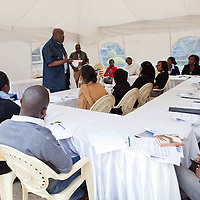 """Dr. Okoth Okombo, a political leadership and communication expert as well as a professor at the University of Nairobi, discusses effective communication skills at the  Fall 2011 Network of Young Women Leaders (NoYWL) """"Answer the Call to Lead"""" training."""