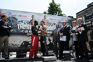 Nathan Cleverly of Wales ® at weigh in preparing for his fight against Sean Corbin of Guyana (l). Weigh in for the 'second coming' 17th May Cardiff boxing show in Queen Street, Cardiff, South Wales on Friday 16th May 2014.<br /> pic by Andrew Orchard, Andrew Orchard sports photography.