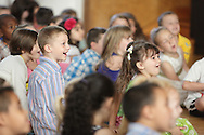 Milton Elementary School students react while watching a slide show of photographs of their school year during the final Moving Up Assembly at the schooll on JUne 19, 2013.