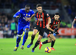 Bournemouth's Andrew Surman (centre) feels pressure from Cardiff City's Sol Bamba during the Premier League match at the Cardiff City Stadium.