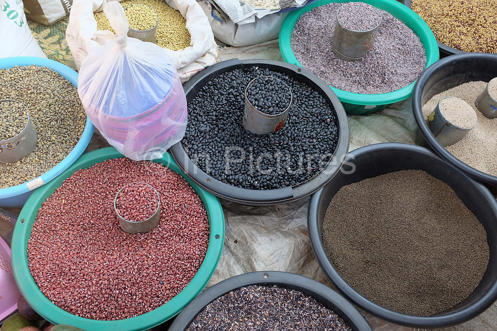 Dried beans, black and white sesame and various kinds of rice for sale at Chiang Dao twice monthly fresh morning market, Chiang Mai province, Thailand. Local hill tribes throng to the market to sell their products and buy necessities.