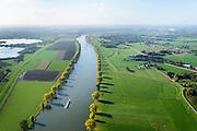 Nederland, Noord-Brabant, Gemeente Cuijk, 24-10-2013; Maas ter hoogte van Kraaijenbergse Plassen. Grensrivier tussen Gelderland en Brabant (Maaskant).<br /> River Meuse, border between Gelderland en Brabant.<br /> luchtfoto (toeslag op standaard tarieven);<br /> aerial photo (additional fee required);<br /> copyright foto/photo Siebe Swart.