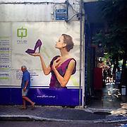 Crete. #commercial #advertisement #billboard #street #woman #man #tourism #crete #chania #public #street #greece