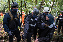 National Eviction Team bailiffs working on behalf of HS2 Ltd try to move an anti-HS2 activist away from a fence being constructed during evictions from a wildlife protection camp in ancient woodland at Jones' Hill Wood on 1 October 2020 in Aylesbury Vale, United Kingdom. Around 40 environmental activists and local residents, some of whom living in makeshift tree houses 60 feet above the ground, were present during the evictions at Jones' Hill Wood which had served as one of several protest camps set up along the route of the £106bn HS2 high-speed rail link in order to resist the controversial infrastructure project.