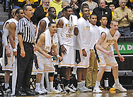 WICHITA, KS - JANUARY 05:  Players of the Wichita State Shockers look on during the second half against the Northern Iowa Panthers on January 5, 2014 at Charles Koch Arena in Wichita, Kansas.  (Photo by Peter G. Aiken/Getty Images) *** Local Caption ***