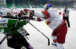 Matej Hocevar of Olimpija vs Daniel Bois of Salzburg during ice-hockey match between HDD Tilia Olimpija Ljubljana (SLO) and EC Red Bull Salzburg (AUT) in 2nd Quaterfinals of EBEL league, on March 1, 2011 in Hala Tivoli, Ljubljana, Slovenia. (Photo By Vid Ponikvar / Sportida.com)