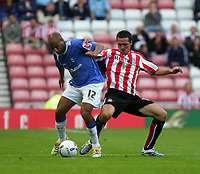 Photo: Andrew Unwin.<br /> Sunderland v Birmingham City. Coca Cola Championship. 09/08/2006.<br /> Sunderland's Tommy Miller (R) looks to tackle Birmingham's Medhi Natfti (L).
