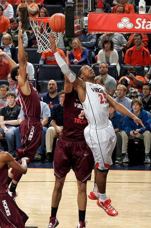 Virginia forward Akil Mitchell (25) shoots the ball during the game Tuesday in Charlottesville, VA. Virginia defeated Virginia Tech73-55.