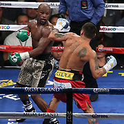 LAS VEGAS, NV - SEPTEMBER 13: Floyd Mayweather Jr. (L) stands in the middle of the ring with Marcos Maidana during their WBC/WBA welterweight title fight at the MGM Grand Garden Arena on September 13, 2014 in Las Vegas, Nevada. (Photo by Alex Menendez/Getty Images) *** Local Caption *** Floyd Mayweather Jr; Marcos Maidana