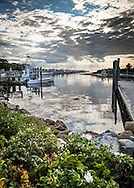 Dramatic lighting and reflections at Rock Harbor in Orleans.
