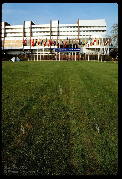 Modernistic headquarters of Council of Europe are fronted by an extensive lawn; (v) Strasbourg. France