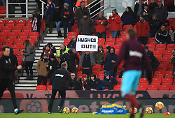 A fan holds a sign in the stands during the Premier League match at the bet365 Stadium, Stoke.