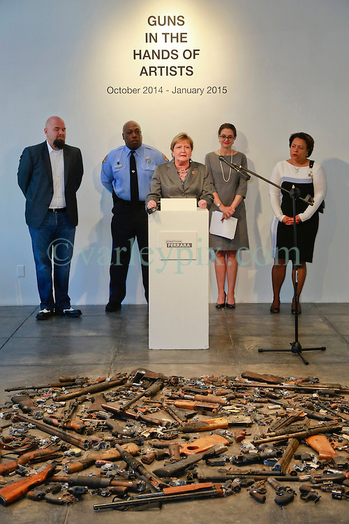 16 April 2014. Jonathan Ferrara Gallery, New Orleans, Louisiana. <br /> L/R; Jonathan Ferrara, Officer Earl Johnson and council members Susan Guidry, Stacy Head and LaToya Cantrell at the Jonathan Ferrara Gallery to announce the 'Guns In The Hands Of Artists' project where artists take parts from 190 destroyed weapons acquired by the New Orleans Police department through a buy-back program and convert them into art.  <br /> Photo; Charlie Varley/varleypix.com