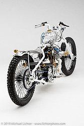 """""""'Plata O Plomo"""", A White with sharpie style painting naked bobber tracker, built from a 1973 HD Ironhead, by Carsten Fritzen, in  Waller, TX.  Photographed by Michael Lichter in Sturgis, SD on 7/31/18. ©2018 Michael Lichter."""