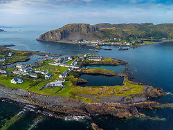 Aerial view from drone of slate islands with Easdale Island front and Ellenabeich village on Seil Island in distance, Argyll and Bute, Scotland, UK