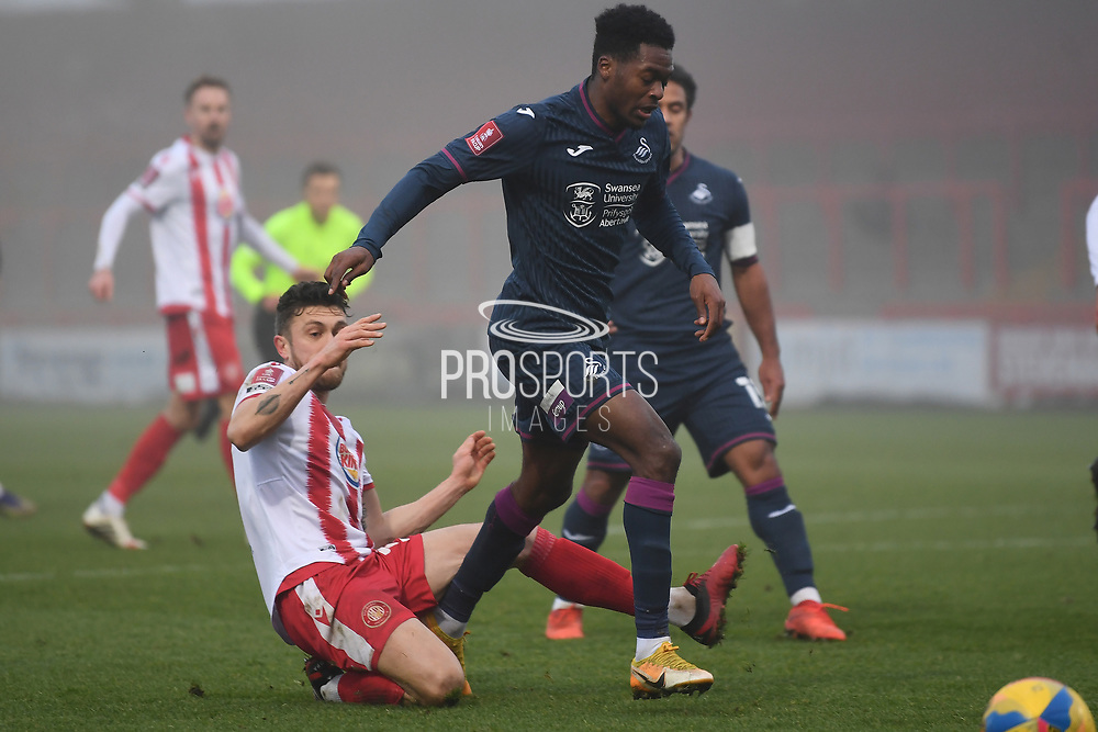 Stevenage defender Ben Coker(3) challenges   Swansea City midfielder Jordan Garrick(41) during the FA Cup match between Stevenage and Swansea City at the Lamex Stadium, Stevenage, England on 9 January 2021.