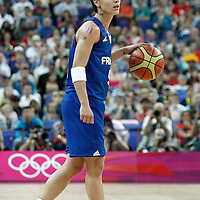 11 August 2012: France Celine Dumerc brings the ball upcourt during 86-50 Team USA victory over Team France, during the Women's Gold Medal Game, at the North Greenwich Arena, in London, Great Britain.