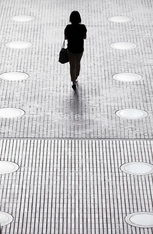 silhouette of woman with handbag walking