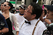 Makoto Sakurai,founder and leader of Zaitokukai, anti-foreigner hate group outside  Yasukuni Shrine, Kudashita, Tokyo, Japan Sunday August 15th 2010. On August 15th every year people gather at Yasukuni Shrine to commemorate the end of the Pacific War. Notionally a call for remembrance and continued peace it is also a Mecca for right wing nationalist and the paramilitary Uyoku dantai.
