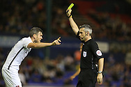 Zander Diamond of Northampton Town is booked during the EFL Sky Bet League 1 match between Oldham Athletic and Northampton Town at Boundary Park, Oldham, England on 16 August 2016. Photo by Simon Brady.