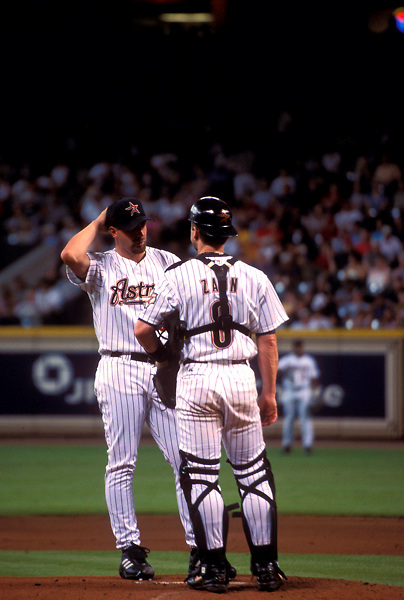Stock photo of a conference between Houston Astros pitcher and catcher.