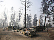 The shells of cars are all that remain after a wildfire swept through the community on White Rock Road, destroying several houses, in Okanogan Sunday, August 23, 2015.<br /> <br /> Sy Bean / The Seattle Times