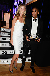 PHARRELL WILLIAMS winner of the performer of The year Award and ROSIE HUNTINGTON-WHITELEY at the GQ Men of The Year Awards 2013 in association with Hugo Boss held at the Royal Opera House, London on 3rd September 2013.