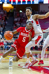 NORMAL, IL - February 16: Darrell Brown turns into the paint defended by Phil Fayne during a college basketball game between the ISU Redbirds and the Bradley Braves on February 16 2019 at Redbird Arena in Normal, IL. (Photo by Alan Look)