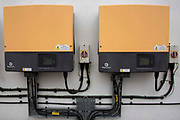 The solar array inverters that monitor and invert the energy made by Brixton Energy Solar who have installed several hundred square metres of solar panels on the roof of Elmore House in the Loughborough Estate in Brixton, London, United Kingdom. Set up by Re-powering London, empower London communities to create their own renewable energy projects.