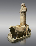 Hittite monumental statue probably of Tarhunda, the Storm God, standing on a cart being pulled by two bulls. Adana Archaeology Museum, Turkey. Against a grey background .<br /> <br /> If you prefer to buy from our ALAMY STOCK LIBRARY page at https://www.alamy.com/portfolio/paul-williams-funkystock/hittite-art-antiquities.html . Type - Adana - in LOWER SEARCH WITHIN GALLERY box. Refine search by adding background colour, place, museum etc.<br /> <br /> Visit our HITTITE PHOTO COLLECTIONS for more photos to download or buy as wall art prints https://funkystock.photoshelter.com/gallery-collection/The-Hittites-Art-Artefacts-Antiquities-Historic-Sites-Pictures-Images-of/C0000NUBSMhSc3Oo