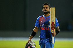 September 6, 2017 - Colombo, Sri Lanka - Indian cricket captain Virat Kohli raises his bat in acknowledgement after his dismissal during the 1st and only T-20 cricket match between Sri Lanka and India at R Premadasa International cricket stadium in Colombo, Sri Lanka on Wednesday 6 September 2017. (Credit Image: © Tharaka Basnayaka/NurPhoto via ZUMA Press)