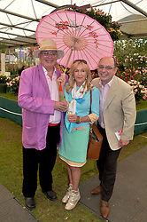 Left to right, CHRISTOPHER BIGGINS, LIZ BREWER and NEIL SINCLAIR at the 2014 RHS Chelsea Flower Show held at the Royal Hospital Chelsea, London on 19th May 2014.