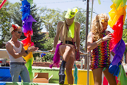 people on a  float at the gay parade in Santa Fe, NM