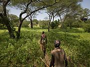 Getting honey with Mokoa, Mahiya and Moloba. At and near the Hadza camp of Mahiya.