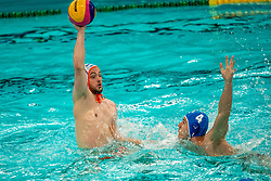 Pascal Janssen of the Netherlands in action against Andrei FuleaTudor of Romania during the Olympic qualifying tournament. The Dutch water polo players are on the hunt for a starting ticket for the Olympic Games on February 16, 2021 in Rotterdam