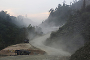 Vast red tracts of land, long dusty roads, scar the green rainforest, carrying a constant cargo of logging trucks moving down, whilst construction machinery moves upwards for the Murum Dam project. Home of the Kenyah native people who once lived in Long Geng, which was flooded by the Bakun Dam. Their community is now dispersed between Sungai Asap, Long Lewan and floating longhouses on the Bakun reservoir. Bakun Belaga region, Sarawak Borneo 2012<br /><br />Borneo native peoples and their rainforest habitat revisited two decades later: 1989/1991-2012. <br /><br />The Bakun hydro-electric dam, which covers 700km². Construction of the dam required the relocation of more than 9,000 native residents, mainly Kayan and Kenyah indigenous peoples who lived in the flooded area. Many Sarawak natives have been relocated to a longhouse settlement named Sungai Asap in Bakun. Most of them were subsistence farmers. Each family were promised only 3 acres of land, insufficient to survive, and many families still have not been compensated for the loss of their longhouses<br /> <br /> Sarawak's primary rainforests have been systematically logged over decades, threatening the sustainable lifestyle of its indigenous peoples who relied on nomadic hunter-gathering and rotational slash & burn cultivation of small areas of forest to survive. Now only a few areas of pristine rainforest remain; for the Dayaks and Penan this spells disaster, a rapidly disappearing way of life, forced re-settlement, many becoming wage-slaves. Large and medium size tree trunks have been sawn down and dragged out by bulldozers, leaving destruction in their midst, and for the most part a primary rainforest ecosystem beyond repair. Nowadays palm oil plantations and hydro-electric dam projects cover hundreds of thousands of hectares of what was the world's oldest rainforest ecosystem which had some of the highest rates of flora and fauna endemism, species found there and nowhere else on Earth, and this deforestation 