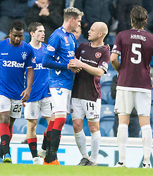 Hearts Steven Naismith (right) and Rangers Kyle Laferty (left) during the Ladbrokes Scottish Premiership match at Ibrox Stadium, Glasgow.
