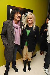 RONNIE & JO WOOD at an exhibition of artist Paul Karslake's work entitled Ideas & Idols, held at Scream, 34 Bruton Street, London W1 on 21st February 2008.<br /><br />NON EXCLUSIVE - WORLD RIGHTS