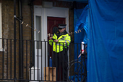 © Licensed to London News Pictures.16/02/2021, London, UK. Police guard a crime scene after a man was fatally stabbed in North London. Police were called to Highgate Road around 7:40pm on Monday. A man was pronounced dead at the scene. Police arrested two men after arriving at Kentish Town. Photo credit: Marcin Nowak/LNP