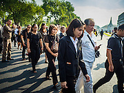 14 OCTOBER 2016 - BANGKOK, THAILAND:  People walk into the Grand Palace in Bangkok to pay respects to Bhumibol Adulyadej, the King of Thailand, who died Oct. 13, 2016. He was 88. His death comes after a period of failing health. With the king's death, the world's longest-reigning monarch is Queen Elizabeth II, who ascended to the British throne in 1952. Bhumibol Adulyadej, was born in Cambridge, MA, on 5 December 1927. He was the ninth monarch of Thailand from the Chakri Dynasty and is known as Rama IX. He became King on June 9, 1946 and served as King of Thailand for 70 years, 126 days. He was, at the time of his death, the world's longest-serving head of state and the longest-reigning monarch in Thai history.    PHOTO BY JACK KURTZ